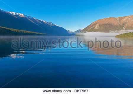 Reflections on lake Rotoiti, Nelson Lakes National Park, South Island, New Zealand - Stock Photo