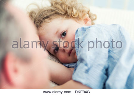 Father and toddler son at bedtime - Stock Photo
