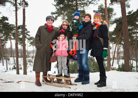 Family portrait of three generations in winter scene - Stock Photo