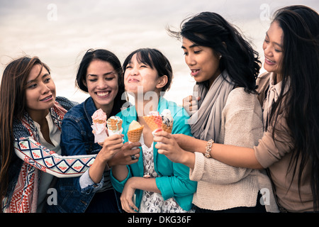 Young women with ice cream cones - Stock Photo