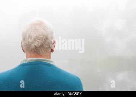 Back view of senior man in blue top - Stock Photo