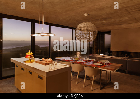 Modern dining room and kitchen overlooking ocean Stock ...