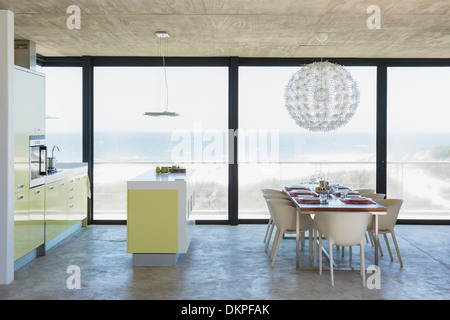 Modern Dining Room And Kitchen Overlooking Ocean