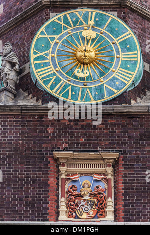 The clock on teh side of the neo-Gothic Town Hall or Ratusz in Wroclaw's market Square. - Stock Photo