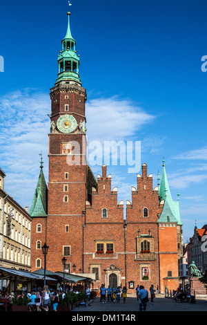 The west face and entrance to the neo-Gothic Town Hall or Ratusz in Wroclaw's market Square. - Stock Photo