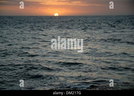 Sunset Over the Sea at Treasure Beach, Jamaica - Stock Photo