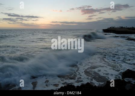 Breaking Waves at Treasure Beach Coast at Sunset, Jamaica - Stock Photo