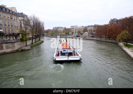 river seine view with tourist sightseeing boat from pont sully bridge in december. paris, france, europe - Stock Photo