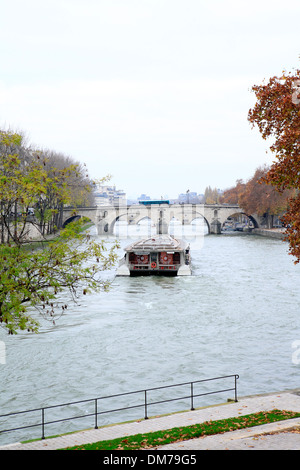 river seine view with tourist sightseeing boat from pont sully bridge at a hazy day in december. paris, france, - Stock Photo