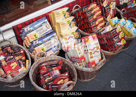 Packets of shortbread biscuits for sale outside a tourist shop in Edinburgh city centre - Stock Photo