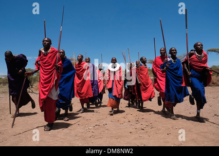 Maasai men dancing traditional dance in the Ngorongoro Conservation Area in the Crater Highlands area of Tanzania - Stock Photo