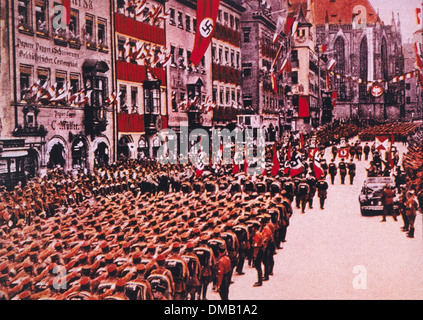 SA Troops Salute Adolf Hitler in Limousine During March Through Nuremberg, Germany, 1933 - Stock Photo