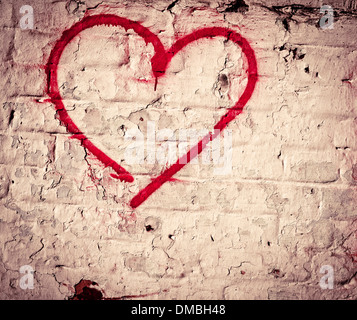 Red Love Heart hand drawn on brick wall grunge textured background trendy street style - Stock Photo