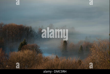 Prague, Czech Republic. 13th Dec, 2013. Clouds laying low due to inversion weather are seen from Jizerske hory mountains - Stock Photo