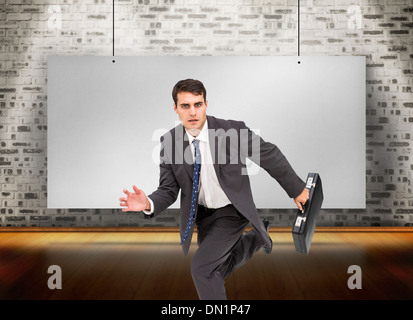 Composite image of stern businessman in a hury - Stock Photo