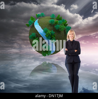 Composite image of friendly businesswoman smiling at the camera in a meeting - Stock Photo