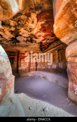 Interior of ancient tomb in Petra, Jordan - Stock Photo