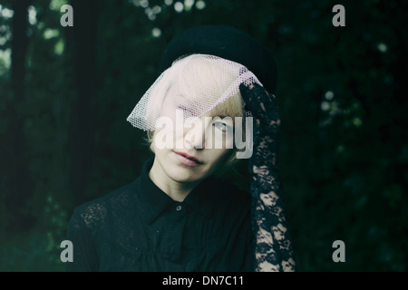 Woman wearing outfit for funeral - Stockfoto
