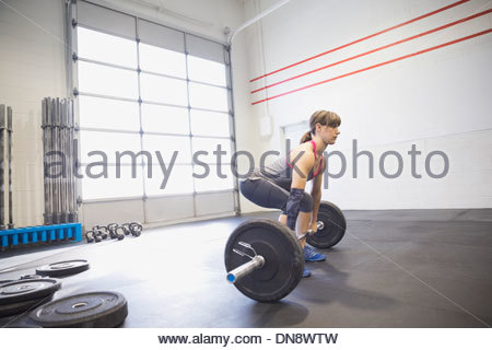 Woman practicing deadlifts - Stock Photo