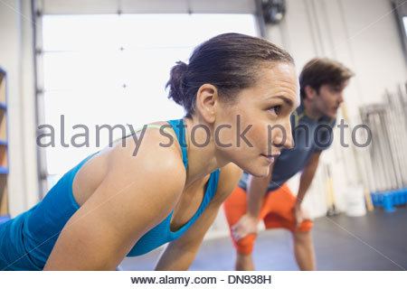 Determined woman in gym - Stock Photo