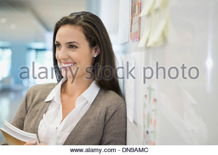 Businesswoman looking away in office - Stock Photo