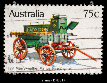 Stamp printed in Australia shows the Merryweather Manual Engine (1851), Historic Fire Engines series, circa 1983 - Stock Photo
