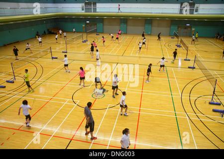 Hong Kong China Island Central Hong Kong Park Sports Centre center badminton courts indoor gymnasium Asian girl - Stock Photo