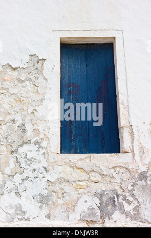 Blue window shutters with white-washed wall, Fiscardo, Kefalonia, Greece - Stock Photo