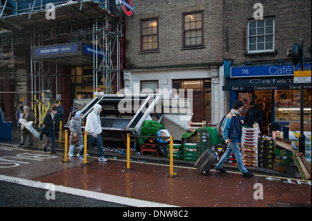 London, UK. 6th Jan, 2014.  Fruit and vegetable stall blown over outside Goodge Street Station on Tottenham Court - Stock Photo