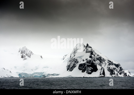 The rugged landscape of the South Shetland Islands along English Strait and Robert Island just off the Antarctic - Stock Photo
