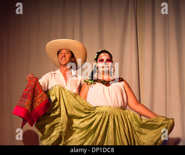 Young men and women in traditional dress dancing at party day of death. Guadalajara, Jalisco. Mexico - Stock Photo