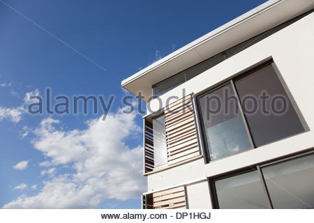 Low angle view of wood shutters on modern house - Stock Photo
