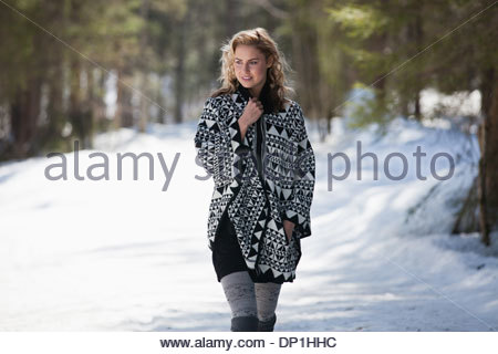 Woman walking in snow - Stock Photo