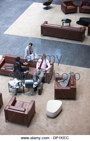 Business people talking on sofa - Stock Photo