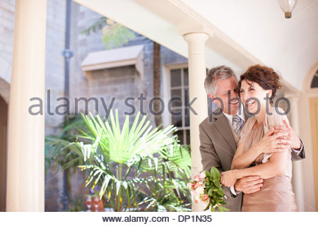 Mature bride and groom smiling - Stock Photo