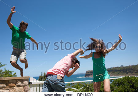 Friends playing on patio - Stock Photo