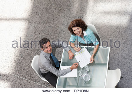 Businessman and businesswoman looking up - Stockfoto