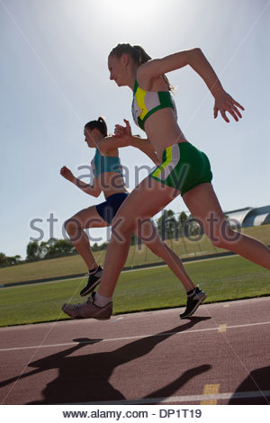 Women running on track - Stock Photo
