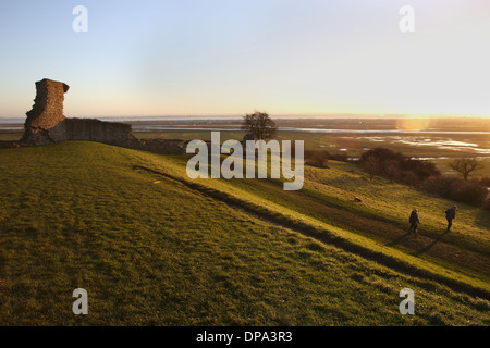 Hadleigh Castle, Hadleigh, Essex, with two people out for a walk just before sunrise. - Stock Photo