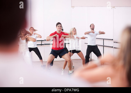 Class doing aerobic training in gym - Stock Photo
