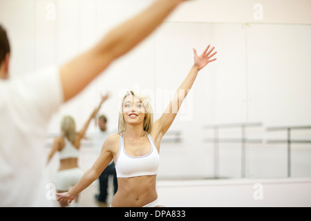 Young woman aerobic training in gym - Stock Photo