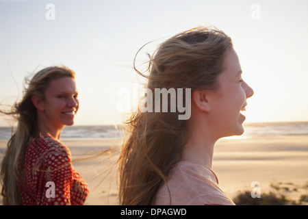 Mother and daughter on windy beach, close up - Stock Photo