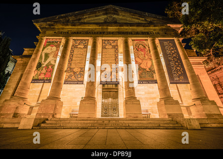 Exterior architectural detail of the ornate Art Gallery of South Australia at night. - Stock Photo