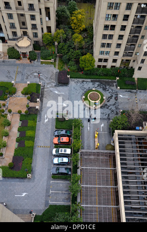 Aerial view of car park, buildings and greenery Shanghai China - Stock Photo