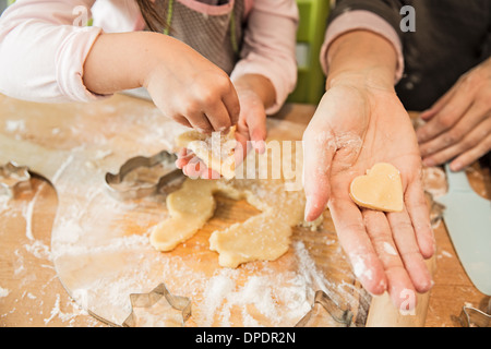 Mother and daughter baking in kitchen - Stock Photo