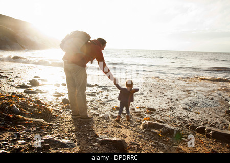 Father and child enjoying beach - Stock Photo