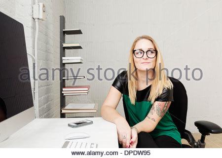 Portrait of businesswoman in design office - Stock Photo
