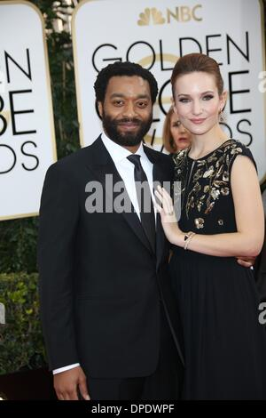 Los Angeles, USA. 11th Jan, 2014. British actor Chiwetel Ejiofor and partner Sari Mercer attend the 71st Annual - Stockfoto