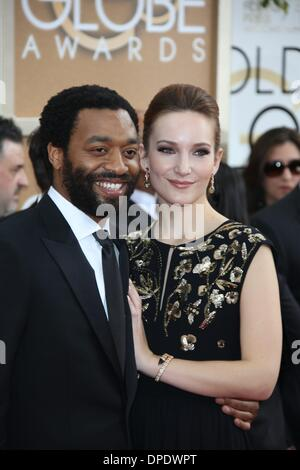 Los Angeles, USA. 11th Jan, 2014. British actor Chiwetel Ejiofor and partner Sari Mercer attend the 71st Annual - Stock Photo