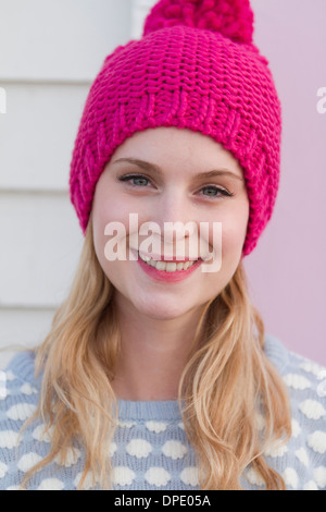 Portrait of young woman in wooly hat - Stock Photo